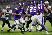 Case Keenum #7 of the Minnesota Vikings hands the ball off to Latavius Murray #25 against the New Orleans Saints during the second half of the NFC Divisional Playoff game at U.S. Bank Stadium on January 14, 2018 in Minneapolis, Minnesota.