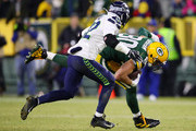 Jimmy Graham #80 of the Green Bay Packers runs after making a reception during the fourth quarter against the Seattle Seahawks in the NFC Divisional Playoff game at Lambeau Field on January 12, 2020 in Green Bay, Wisconsin.