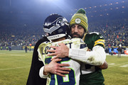 Tyler Lockett #16 of the Seattle Seahawks hugs Aaron Rodgers #12 of the Green Bay Packers after the NFC Divisional Playoff game at Lambeau Field on January 12, 2020 in Green Bay, Wisconsin.