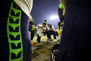 Russell Wilson #3 of the Seattle Seahawks prays on the field after being defeated by the Green Bay Packers 28-23 in the NFC Divisional Playoff game at Lambeau Field on January 12, 2020 in Green Bay, Wisconsin.