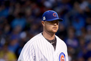 Jon Lester #34 of the Chicago Cubs walks off the field in the fifth inning during game four of the National League Division Series against the Washington Nationals at Wrigley Field on October 11, 2017 in Chicago, Illinois.