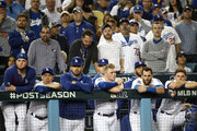 The Los Angeles Dodgers look on from the dug out as they lose to the Washington Nationals 7-3 in ten innings of game five and the National League Division Series at Dodger Stadium on October 09, 2019 in Los Angeles, California.