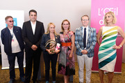 Rosalie Varda (third left) who received the Documentary Prize on behalf of her mother Agnes Varda with (L-R) Lorenzo Codelli, Dror Moreh, Sandrine Bonnaire, Thom Powers and Lucy Walker during the 70th annual Cannes Film Festival at Palais des Festivals on May 27, 2017 in Cannes, France.