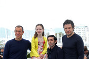 """(L-R) Director Matteo Garrone, Alida Baldari Calabria, Marcello Fonte and Edoardo Pesce attend """"Dogman"""" Photocall during the 71st annual Cannes Film Festival at Palais des Festivals on May 17, 2018 in Cannes, France."""