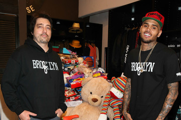 Dom DeLuca Chris Brown Hosts a Xmas Toy Drive