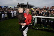 Paul Hanagan is crowned champion jockey and celebrates with his son Josh at Doncaster racecourse on November 05, 2011 in Doncaster, England.