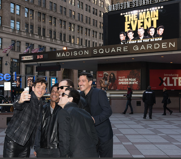 New Kids on the Block Press Conference [new kids on the block press conference,new kids on the block,people,city,advertising,urban area,crowd,street,night,building,photography,pedestrian,joey mcintyre,jordan knight,jonathan knight,danny wood,donnie wahlberg,selfie,madison square garden,press conference]
