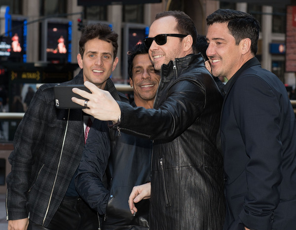 New Kids on the Block Press Conference [new kids on the block press conference,leather jacket,event,jacket,eyewear,textile,leather,photography,gesture,premiere,vision care,jonathan knight,joey mcintyre,danny wood,donnie wahlberg,selfie,madison square garden,new york city,press conference]