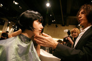 Stylist Edward Tricomi works with a model backstage at the Douglas Hannant Fall 2011 fashion show during Mercedes-Benz Fashion Week at The Plaza Hotel on February 16, 2011 in New York City.