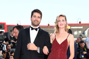 Geoffroy Lefebvre and Eva Riccobono walk the red carpet ahead of the 'Downsizing' screening and Opening Ceremony during the 74th Venice Film Festival at Sala Grande on August 30, 2017 in Venice, Italy.