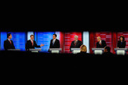 (L-R) Texas Gov. Rick Perry speaks while Rick Santorum, former Massachusetts Gov. Mitt Romney, former speaker of the House Newt Gingrich, U.S. Rep. Ron Paul (R-TX),  and U.S. Rep. Michele Bachmann (R-MN), look during the ABC News GOP Presidential debate on the campus of Drake University on December 10, 2011 in Des Moines, Iowa. Rivals were expected to target front runner Gingrich in the debate hosted by ABC News, Yahoo News, WOI-TV, The Des Moines Register and the Iowa GOP.