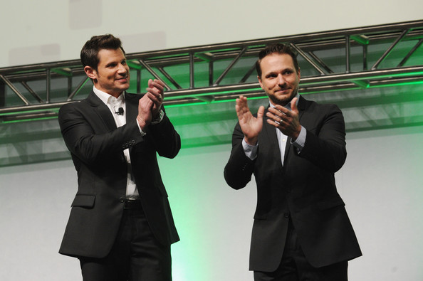 Inside the 2014 A+E Networks Upfront  [a e networks,l,suit,businessperson,white-collar worker,formal wear,technology,event,photography,gesture,conversation,performance,new york city,nick lachey,drew lachey]