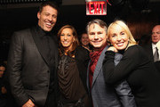 (L-R) Life Coach Tony Robbins, Designer Donna Karan, Founder of DuJour Media Jason Binn and Sage Robbins attend DuJour Magazine's Jason Binn and Invicta Watches in the welcoming of Tony Robbins to New York at Catch NYC on November 17, 2014 in New York City.