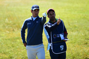 Matteo Manassero of Italy gestures with his caddie on the 18th hole during the first round of the Dubai Duty Free Irish Open at Balllyliffin Golf Club on July 5, 2018 in Ballyliffin,Ireland.