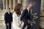 Catherine, Duchess of Cambridge walks with Sir Michael Dixon (L), Director of the Natural History Museum and Stephen Deuchar, director of the Art Fund as she arrives to present the Art Fund Museum of the Year 2016 prize at a dinner hosted at the Natural History Museum on July 6, 2016 in London, United Kingdom. The Art Fund Museum of the Year prize is awarded annually to one outstanding museum which has shown exceptional imagination, innovation and achievement in the preceding year.