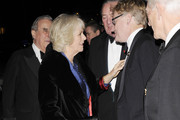 Camilla, Duchess of Cornwall and Simon Brooks-Ward attend The London International Horse show at Olympia Exhibition Centre on December 19, 2013 in London, England.