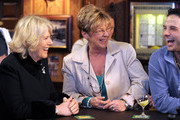 Camilla, The Duchess of Cornwall (2L) meets actors Anne Kirkbride, who plays the role of Deirdre Barlow (C) and Ryan Thomas, who plays the role of Jason Grimshaw (R) during a tour to the Rovers Return Pub on the set of British television soap opera 'Coronation Street' on February 4, 2010 in Manchester, England.
