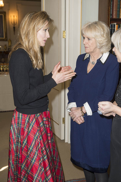 Camilla, Duchess of Cornwall greets actress Natasha McElhone as she attends the Women of the World Festival at Clarence House on February 27, 2014 in London, England.