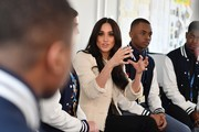 Meghan, Duchess of Sussex sits in on a discussion of the 'Senior Debate Squad' during a visit to Robert Clack School in Dagenham ahead of International Women's Day (IWD) held on Sunday 8th March, on March 6, 2020 in London, England.