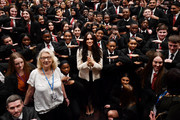 Meghan, Duchess of Sussex poses with school children making the 'Equality' sign following a school assembly during a visit to Robert Clack School in Dagenham to attend a special assembly ahead of International Women's Day (IWD) held on Sunday 8th March, on March 6, 2020 in London, England.