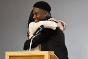 Meghan, Duchess of Sussex embraces student Aker Okoye during a special school assembly at the Robert Clack Upper School in Dagenham ahead of International Women's Day (IWD) held on Sunday 8th March, on March 6, 2020 in London, England.