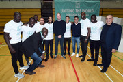Prince William, Duke of Cambridge, poses with footballers during the graduation ceremony of 30 Young Peace Leaders from Football for Peace's UK City for Peace programme at Copper Box Arena on November 22, 2018 in London, England.