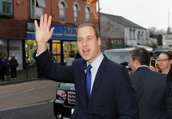 Prince William, Duke of Cambridge waves as he leaves Birmingham City Council after his visit to South and City College on November 29, 2013 in Birmingham, England.