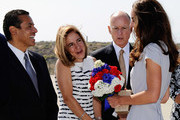 (L-R) Los Angeles Mayor Antonio Villaraigosa,  Anne Gust and Governor Jerry react after giving a red, white and blue bouquet of flowers to Catherine, Duchess of Cambridge after she and  Prince William, Duke of Cambridge, arrive at Los Angeles International Airport on July 8, 2011 in Los Angeles, California. The newly married Royal Couple are on a three day visit to Southern California.