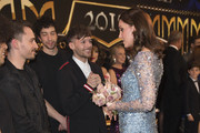 Catherine, Duchess of Cambridge speaks to Louis Tomlinson and performers on stage as they attend the Royal Variety Performance at the Palladium Theatre on November November 24, 2017 in London, England. The Royal Variety Performance takes place every year, either in London or in a theatre around the United Kingdom. The event is in aid of the Royal Variety Charity, formally, The Entertainment Artistes Benevolent Fund, of which The Queen is Patron. The money raised from the show helps hundreds of entertainers throughout the UK, who need help and assistance as a result of old age, ill-health, or hard times.