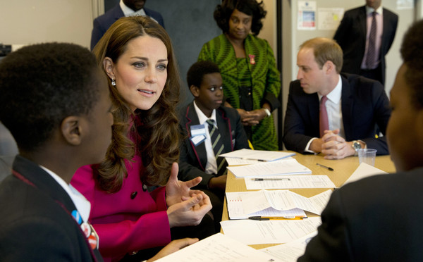 Catherine, Duchess of Cambridge and Prince William, Duke of Cambridge talk to young students who are taking part in a role playing lesson about the workings of a British court at Stephen Lawrence Centre in Deptford on March 27, 2015 in London, England. The centre is built in memory of 19 years old Stephen Lawrence, who was stabbed to death by a group of white youths in April 1993 as he was waiting for a bus.