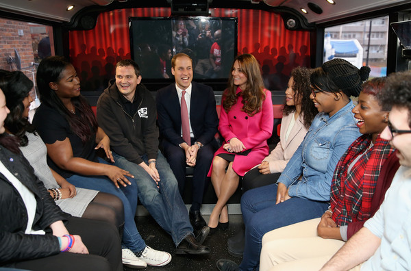 Catherine, Duchess of Cambridge and Prince William, Duke of Cambridge joke with young people on the top deck of the XLP Mobile recording Studio on March 27, 2015 in London, England.