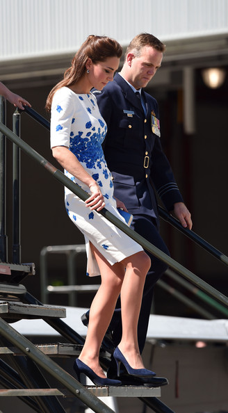 Catherine, Duchess of Cambridge (L) and Commanding Officer of Number 1 Squadron , Wing Commander Stephen Chappell (R) walk from a RAAF Super Hornet of 1 Squadron at the Royal Australian Airforce Base at Amberley on April 19, 2014 in Brisbane, Australia. The Duke and Duchess of Cambridge are on a three-week tour of Australia and New Zealand, the first official trip overseas with their son, Prince George of Cambridge.