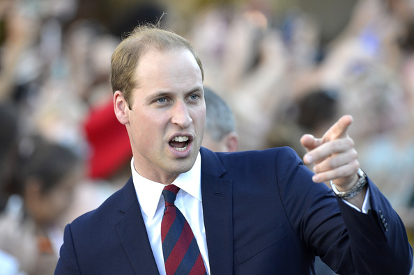 Prince William, Duke of Cambridge is seen pointing to something in the crowd on April 19, 2014 in Brisbane, Australia. The Duke and Duchess of Cambridge are on a three-week tour of Australia and New Zealand, the first official trip overseas with their son, Prince George of Cambridge.