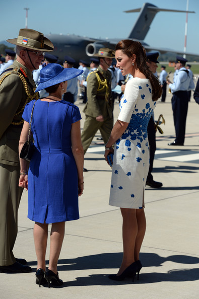 Catherine, Duchess of Cambridge talks to the Chief of the Defence Force General David Hurley and Mrs Hurley after arriving at Royal Australian Airforce Base at Amberley on April 19, 2014 in Brisbane, Australia. The Duke and Duchess of Cambridge are on a three-week tour of Australia and New Zealand, the first official trip overseas with their son, Prince George of Cambridge.
