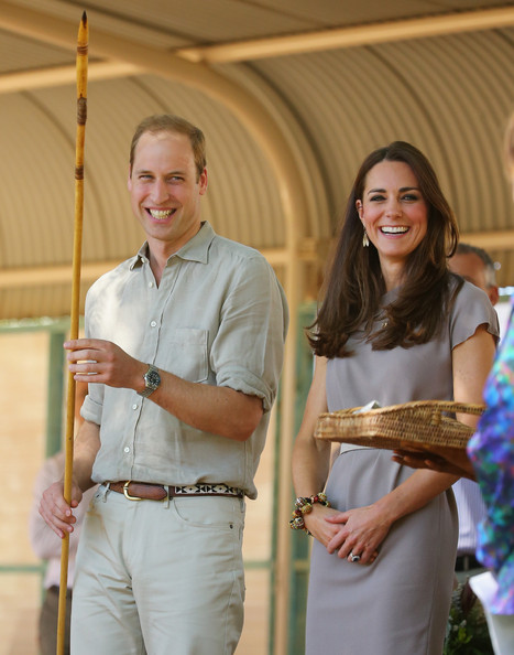 Catherine, Duchess of Cambridge and Prince William, Duke of Cambridge are presented with an Aboriginal spear as they arrive at the National Indigenous Training Academy on April 22, 2014 in Ayers Rock, Australia. The Duke and Duchess of Cambridge are on a three-week tour of Australia and New Zealand, the first official trip overseas with their son, Prince George of Cambridge.