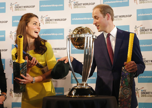 Prince William, Duke of Cambridge and Catherine, Duchess of Cambridge hold cricket bats presented to them in front of the Cricket World Cup during a reception at the Sydney Opera House on April 16, 2014 in Sydney, Australia. The Duke and Duchess of Cambridge are on a three-week tour of Australia and New Zealand, the first official trip overseas with their son, Prince George of Cambridge.