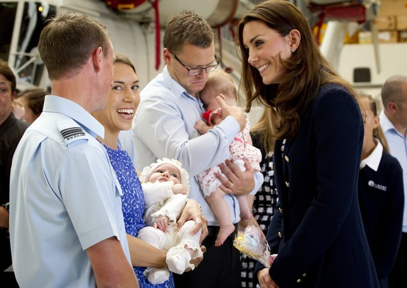 Catherine, Duchess of Cambridge greets Jane, Blair and 10-week-old Grace Oldershaw after arriving at Whenuapai on April 11, 2014 in Auckland, New Zealand.  The Duke and Duchess of Cambridge are on a three-week tour of Australia and New Zealand, the first official trip overseas with their son, Prince George of Cambridge.