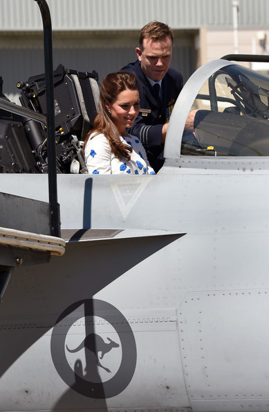 Commanding Officer of Number 1 Squadron , Wing Commander Stephen Chappell (R), gives details to Catherine, the Duchess of Cambridge (L) as she sits in the cockpit of a RAAF Super Hornet of 1 Squadron at the Royal Australian Airforce Base at Amberley on April 19, 2014 in Brisbane, Australia. The Duke and Duchess of Cambridge are on a three-week tour of Australia and New Zealand, the first official trip overseas with their son, Prince George of Cambridge.