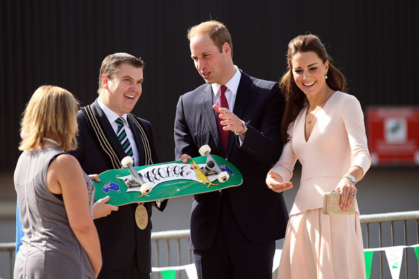 City of Playford Mayor, Mr Glenn Docherty, presents a skateboard to Prince William, Duke of Cambridge and Catherine, Duchess of Cambridge at a skate park in Elizabeth, on April 23, 2014 in Adelaide, Australia. The Duke and Duchess of Cambridge are on a three-week tour of Australia and New Zealand, the first official trip overseas with their son, Prince George of Cambridge.