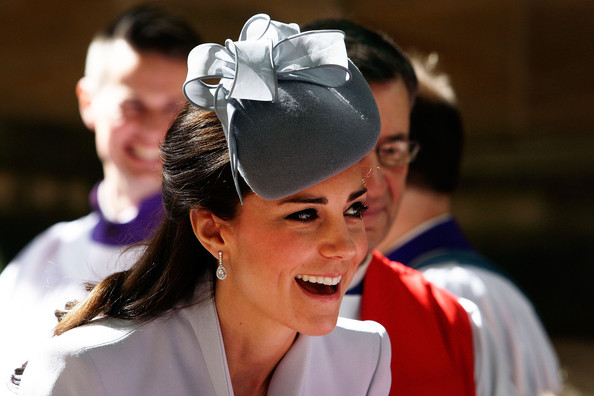 Catherine, Duchess of Cambridge greets members of the cathedral choir following Easter Sunday Service at St Andrews Cathedral on April 20, 2014 in Sydney, Australia. The Duke and Duchess of Cambridge are on a three-week tour of Australia and New Zealand, the first official trip overseas with their son, Prince George of Cambridge.