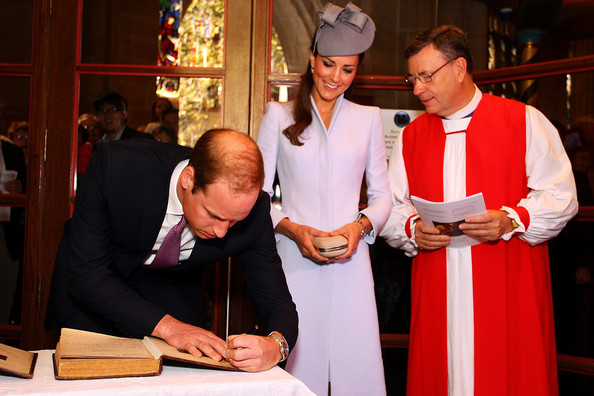 Prince William, Duke of Cambridge (L) and Catherine, Duchess of Cambridge (C) sign the First Fleet Bible and Prayer Book following Easter Sunday Service at St Andrews Cathedral on April 20, 2014 in Sydney, Australia. The Duke and Duchess of Cambridge are on a three-week tour of Australia and New Zealand, the first official trip overseas with their son, Prince George of Cambridge.
