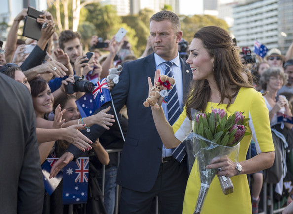 Catherine, Duchess of Cambridge holds flowers as she attends a reception hosted by the Governor and Premier of New South Wales on April 16, 2014 in Sydney, Australia. The Duke and Duchess of Cambridge are on a three-week tour of Australia and New Zealand, the first official trip overseas with their son, Prince George of Cambridge.