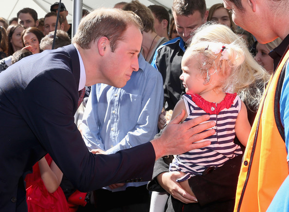 Prince William, Duke of Cambridge meets a young girl as he visits Pacific Aerospace on April 12, 2014 in Hamilton, New Zealand. The Duke and Duchess of Cambridge are on a three-week tour of Australia and New Zealand, the first official trip overseas with their son, Prince George of Cambridge.