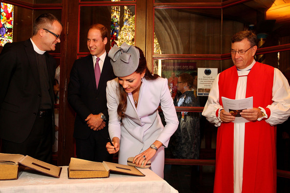 Prince William, Duke of Cambridge (2nd L) and Catherine, Duchess of Cambridge (C) sign the First Fleet Bible and Prayer Book following Easter Sunday Service at St Andrews Cathedral on April 20, 2014 in Sydney, Australia. The Duke and Duchess of Cambridge are on a three-week tour of Australia and New Zealand, the first official trip overseas with their son, Prince George of Cambridge.