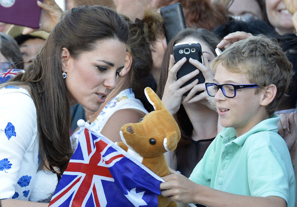 Catherine, Duchess of Cambridge is given a toy kangaroo by a young boy on April 19, 2014 in Brisbane, Australia. The Duke and Duchess of Cambridge are on a three-week tour of Australia and New Zealand, the first official trip overseas with their son, Prince George of Cambridge.