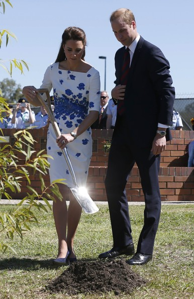 Catherine, Duchess of Cambridge and Prince William, Duke of Cambridge plant a Plunkett Mallee tree at the Memorial Garden during a visit to the Royal Australian Airforce Base at Amberley on April 19, 2014 in Brisbane, Australia. The Duke and Duchess of Cambridge are on a three-week tour of Australia and New Zealand, the first official trip overseas with their son, Prince George of Cambridge.