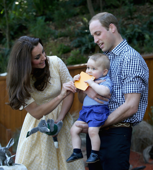 Prince William, Duke of Cambridge holds  Prince George of Cambridge as he chews a sticker during a visit to at Taronga Zoo on April 20, 2014 in Sydney, Australia. The Duke and Duchess of Cambridge are on a three-week tour of Australia and New Zealand, the first official trip overseas with their son, Prince George of Cambridge.