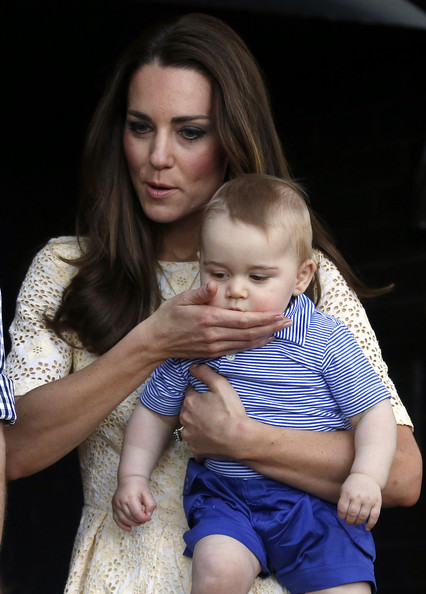 Catherine, Duchess of Cambridge wipes the mouth of her son Prince George of Cambridge as they look at an Australian animal called a Bilby, which has been named after the young Prince, during a visit to Sydney's Taronga Zoo on April 20, 2014 in Sydney, Australia. The Duke and Duchess of Cambridge are on a three-week tour of Australia and New Zealand, the first official trip overseas with their son, Prince George of Cambridge.