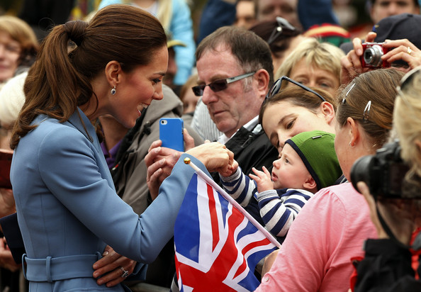 Catherine, Duchess of Cambridge speaks with members of the crowd at a ceremony at the war memorial in Seymour Square on April 10, 2014 in the town of Blenheim, New Zealand. The Duke and Duchess of Cambridge are on a three-week tour of Australia and New Zealand, the first official trip overseas with their son, Prince George of Cambridge.