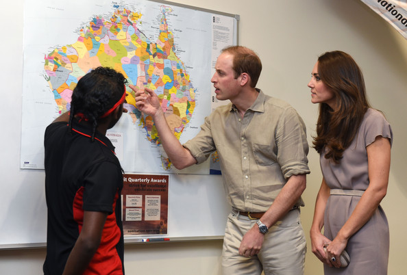Prince William, Duke of Cambridge and Catherine, Duchess of Cambridge look at an Aboriginal map showing the location of indigenous language groups pre-European settlement during a visit to the National Indigenous Training Academy at Yulara on April 22, 2014 in Ayers Rock, Australia. The Duke and Duchess of Cambridge are on a three-week tour of Australia and New Zealand, the first official trip overseas with their son, Prince George of Cambridge.